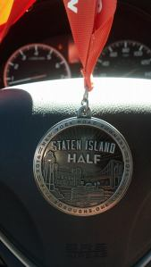 Took this picture of my medal while hanging out in uber traffic